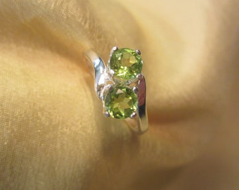 Size Seven Sterling Ring with Side By Side Round Peridots