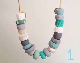 Beaded cotton cord necklaces, each unique.