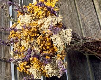 Dried flowers.  Wildflower bouquet, yellow, white, purple.  Tansy, Yarrow.  Floral arrangement, centerpiece.
