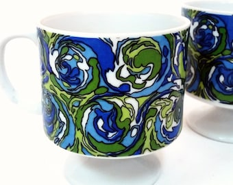 Nice  ceramic Cup with blue and green psychadelic design