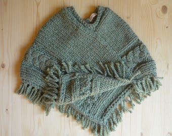 Poncho with fringe daughter (4t). Olive green