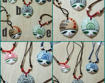 Ceramic face necklace different  and Each face has it own features that make it unique colors , Face Pendant, Unique Jewelry , Hand made,