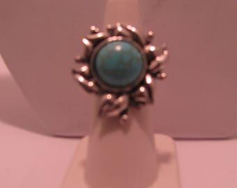 Turquoise ring in sunburst pattern