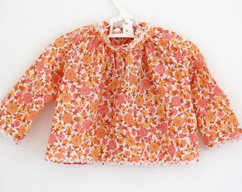 Vintage Mothercare long-sleeve tunic in retro floral pattern and decorative trim, approx age 6 months