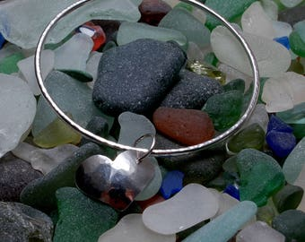 Silver bangle with hammered heart