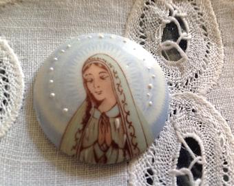Vintage porcelain cabochon has religious decor