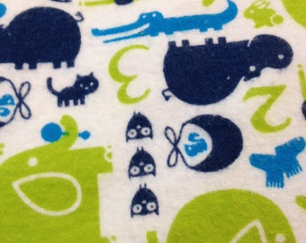 A animal print in navy and green fitted crib /toddler sheet