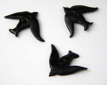 Handmade black swallow button