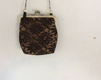 Black lace and beige faux leather purse