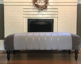 One of a kind upholstered ottoman in neutral grays