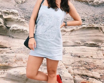 Handmade linen dress with hand embroidered abstract faces