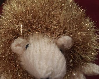 Gold fluffy tinsel knitted hedgehog child friendly white and green face soft touch christmas hedgehog soft stuffing typical uk style