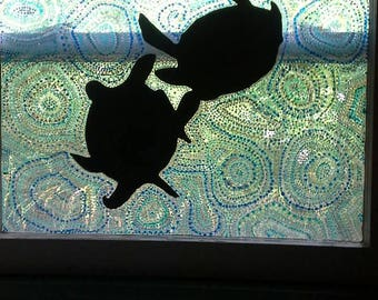 Great sea turtles courtship dance with swirling blue water ripples, stained glass painted old wood window