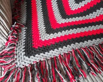 Hand crocheted fringed lap blanket