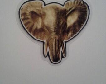 Upcycled laminated elephant magnet