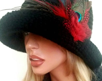 Elegant hat, crochet made with  feathers.