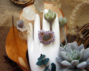 Magical statement ring with polished amethyst stalactite set in sterling silver. 2 mm wide hammered band, size 6.