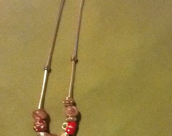 Silver chain with pink beats and charm