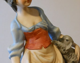 Tall Young Girl with a Dog Figurine