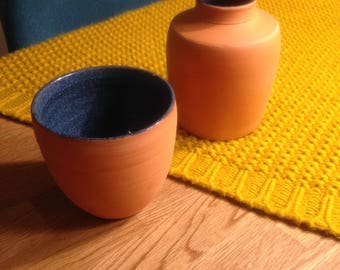 Pot and terracotta red with dark blue inside Bowl