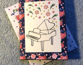 Handmade stitched piano with flowers birthday card.