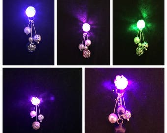 LED light-up earring shines like Brilliant precious stones. Carefully tested before shipping. Free extra battery.