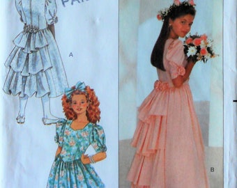 Butterick 4529.  Girl special occasion dress.  Junior Bridesmaid dress. First Communion dress. Confirmation dress. Party dress. Size 12-14.