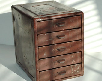 File A Way Chest Small Metal Cabinet With Assorted Drawers