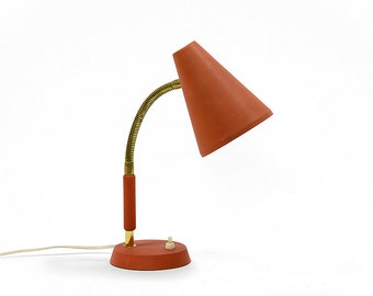 Vintage 1950s gooseneck table lamp with matte red lacquer. Good working condition but with a few marks and scratches of time. Swedish made.