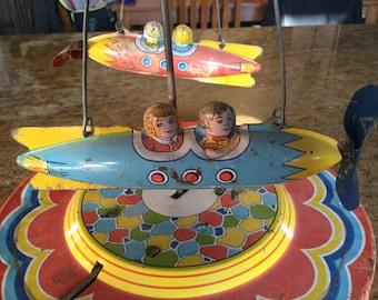 Vintage Wind Up Chein Tin Litho Rocket Ride Toy