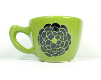 a 12oz cup with Dahlia flower prints, shown here on avocado green glaze -  READY TO SHIP