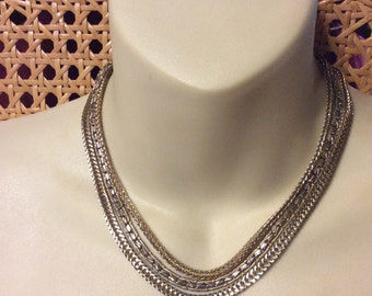 Multi strand chain collar necklace.