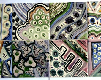 set of 8 hand painted ceramic tiles