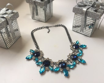 Blue/turqoise flower shaped statement necklace