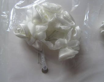 set of 2 bunches of 7 flowers each metal rod - cream colored satin is 14 flowers