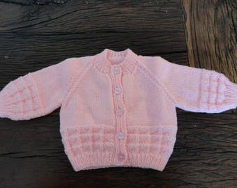 "Pink baby round neck cardigan check pattern across bottom and sleeves, hand knitted,  baby clothes 20"" chest"