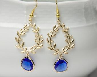 Gold and blue earrings. Blue glass earrings. Gold laurel earrings. Framed Glass earrings. Glass dangle earrings. Cobalt Blue earrings.