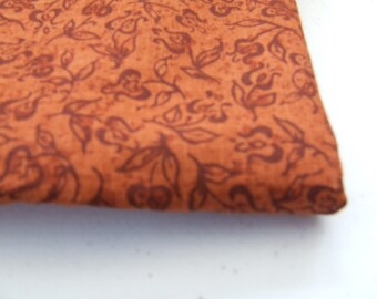 Dark orange and deep rust print cotton fabric