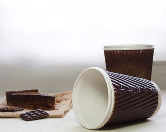 Coffee cup or ceramic travel mug. Porcelain cup in chocolate brown and white. Ceramic travel cup for use as a tea cup or coffee cup. .