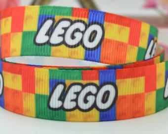 Trendy colourful Lego logo print 15mm single sided 100% polyester, grosgrain ribbon per metre.
