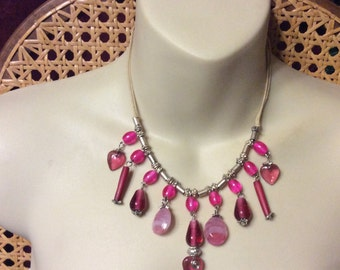 Lamp work pink glass heart beads necklace.