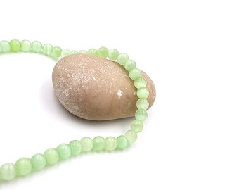 65 6mm light green cat eye beads