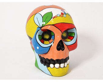 Skull sculpture, multicolored resin. Height 17 inches