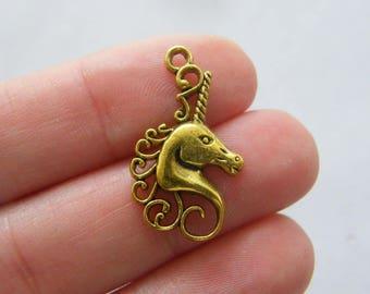 6 Unicorn charms antique gold tone GC175
