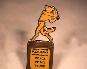 Limited Edition Wes Anderson inspired Whack-Bat champ gold trophy pin