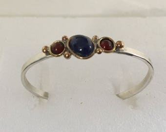 Sterling silver cuff bracelet with brass accents and carnelian and lapis stones