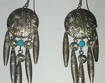 Dangle earrings with turquoise stone and native American flair