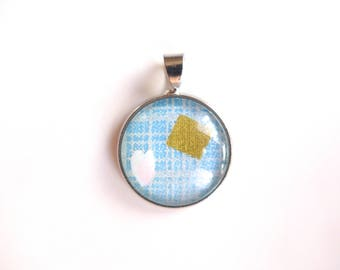 Gold round petal pattern and square pendant on blue and silver. Japanese washi paper + glass cabochon.
