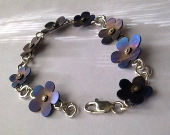 Sterling silver and coloured titanium flower bracelet