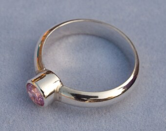 Silver ring with pink CZ